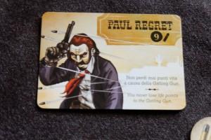 Voici mon personnage pour cette première partie de l'après-midi : je suis Paul Regret, celui qui ne perd jamais aucun point de vie à cause des rafales de balles. Pas un super pouvoir, assurément, mais il démarre avec 9 PV et ça me va bien. Au niveau de mon rôle caché, je suis un hors-la-loi dont le seul but dans la vie est de dézinguer le shérif...