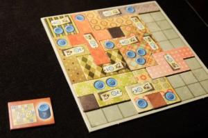 Yes ! Je réussis un patchwork de 7 par 7 en premier et j'obtiens donc le précieux bonus de 7 boutons...