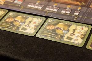 Parmi les quatre cartes d'ouvriers mises en vente lors du deuxième tour, les deux cartes ci-dessus sont très proches l'une de l'autre : elles permettent de renvoyer un autre de ses ouvriers, soit en n'étant pas payé, soit en ne profitant pas de son bonus...