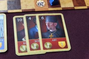 Petit exemple d'illustrations des nobles : vous aimez vous ? Bon, moi perso, j'aime bien la tête à Stefan Feld à droite des nobles possédés par Laurent à ce moment du jeu...