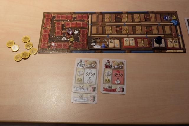 Le plateau individuel d'Axel et ses 3 cartes valant des titres... Il a réussi, lui aussi, à aller au bout de la piste des diamants, mais sur celle des livres, c'est nettement moins bien...