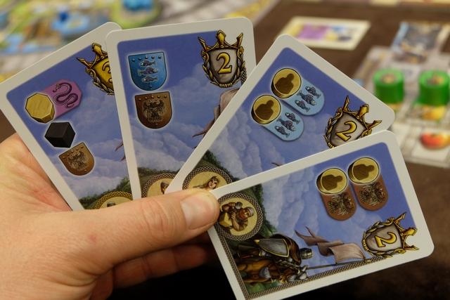 Voici ma main de cartes de quêtes en début de partie...