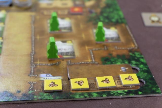 Trois Factory pour trois entrepôts rasés ! Rien que ça... Et la bouffe, en-dessous, pour nourrir mes 4 citadins jaunes avant la toute fin de partie. Je l'aime cette partie !