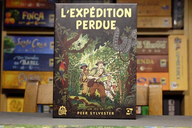 """Avec son incroyable proximité graphique avec """"Tintin et les Picaros"""", le jeu L'Expédition Perdue, qui n'est pas une BD mais bien un jeu, promet de nous immerger dans une aventure incroyable, au cœur de la jungle amazonienne, à la recherche de l'El Dorado... Ça donne plus qu'envie !!! Et, comme il se joue en solo, plutôt bien prévu pour cette config' d'ailleurs, et bien il va parfaitement aller pour m'accompagner aujourd'hui..."""