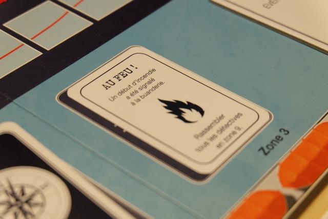 Comme en début de chaque tour, correspondant à l'utilisation de 3 points d'action par joueur (on y revient), une carte d'événement est piochée : ci-dessus, chacun de nous doit aller dans la zone 9 au lieu de rester dans le grand salon comme habituellement en début de partie.